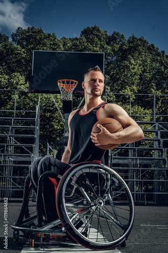 Fotografia, Obraz  Portrait of cripple basketball player in wheelchair.