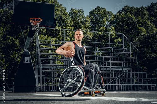 Foto  Portrait of cripple basketball player in wheelchair.