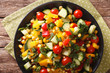 Vegetable salad of corn, greens, tomatoes, cucumbers and pepper. horizontal top view