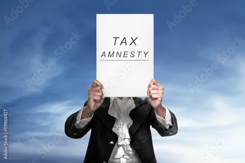 The human holding paper reads tax amnesty Canvas Print