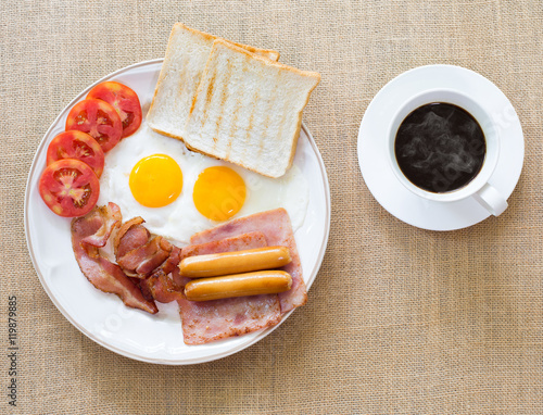 Foto op Plexiglas Gebakken Eieren American breakfast, bacon, fried egg, ham and sausage in white d
