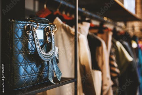 Handbags and clothes in a fashion store - fototapety na wymiar