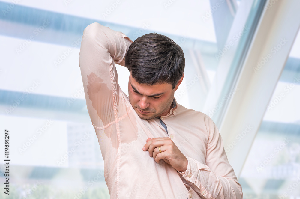 photo art print man with hyperhidrosis sweating under armpit in