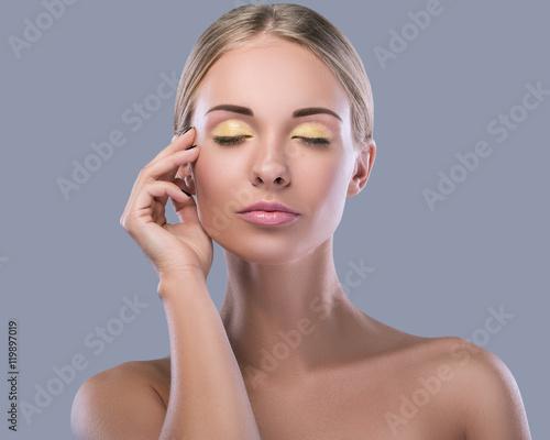 Obraz na plátně  Beautiful blonde woman with bright makeup