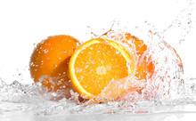 Fresh Oranges In Splashing Water Isolated On White