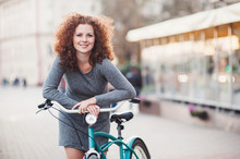 Beautiful Happy Young Woman With Bicycle On A City Street. Active Lifestyle Concept
