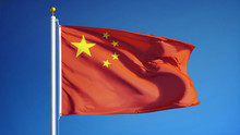 China Flag Waving Against Clean Blue Sky, Close Up, Isolated With Clipping Path Mask Alpha Channel Transparency