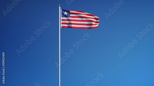 Liberia flag waving against clean blue sky, long shot