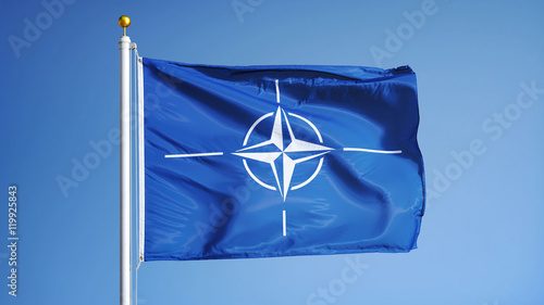 NATO flag waving against clean blue sky, close up, isolated with clipping path m Canvas Print