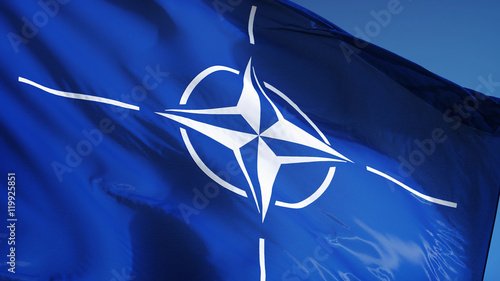 NATO flag waving against clean blue sky, close up, isolated with clipping path m Wallpaper Mural
