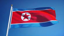North Korea Flag Waving Agains...