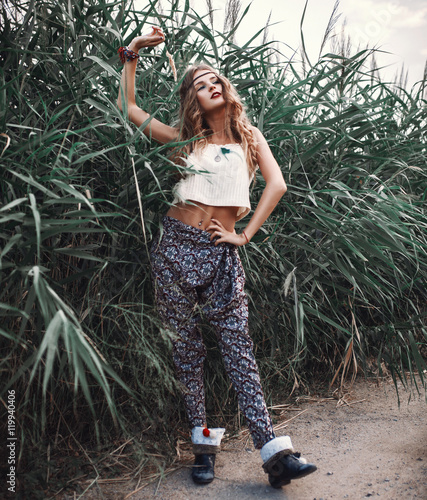 Outdoor hippie portrait of young beautiful woman. Boho chic styl