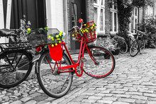 Retro Vintage Red Bicycle On Cobblestone Street In The Old Town.