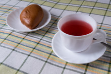 White Cup With Fruit Tea And Cake In The Plate