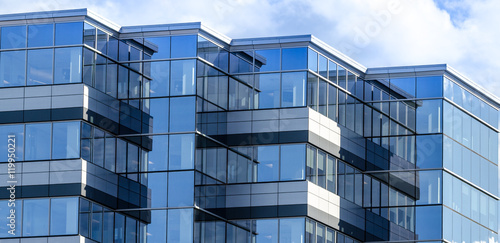 Foto auf Gartenposter Stadtgebaude Lines, glass and reflections of modern architecture. Glass panelled building of new office space in Moncton, New Brunswick. New commercial real estate in the city.