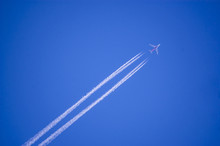 Plane Flying On A Perfectly Bl...