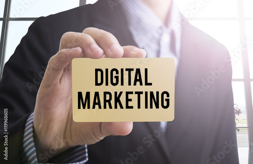 Businessman Hand Holding A Business Card With A Message Digital