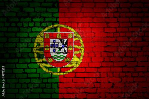 Photo  Portugal flag on a brick wall