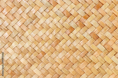 Fotografía  traditional thai style pattern nature background of brown handicraft weave textu