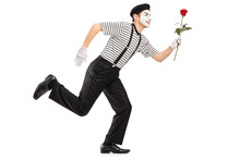 Mime Artist Running And Holding A Rose Flower