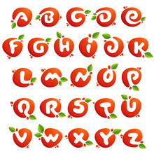 Alphabet Letters In Fresh Juice Splash With Green Leaves.