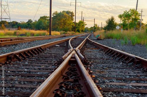 Fotografie, Obraz  Cargo train platform at sunset. Railroad in Ukraine. Railway
