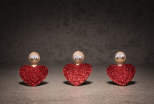 Toy Figurines Holding Red Hear...