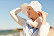 Happy Senior Woman In Sun Hat On Summer Beach