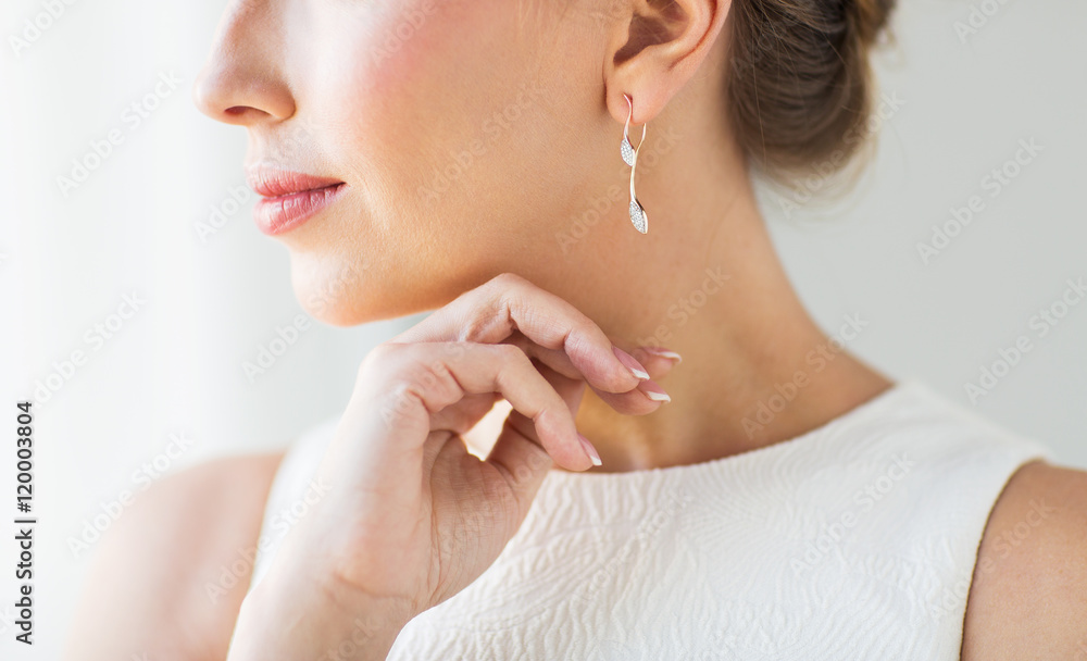 Fototapeta close up of beautiful woman face with gold earring