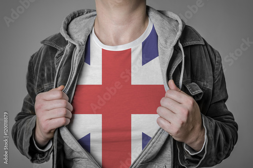 Photo  Man showing Great Britain flag on t-shirt.