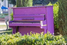 Old Purple Piano Stands In The...
