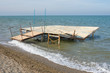 Break a small wooden pier on the seashore