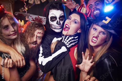 Obraz Spooky costumes of party people. - fototapety do salonu