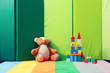 Different toys with carpet on green background