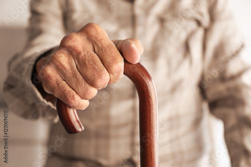 Fotografie, Obraz  Old man hand holding walking stick