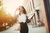 Fototapeta Londyn - Businesswoman in a rush