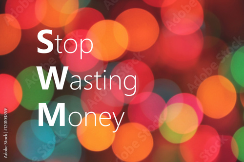 Fotografie, Obraz  Stop Wasting Money text on colorful bokeh background