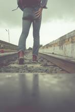 Traveller Walking On Railroad With Vintage Filter Effect.