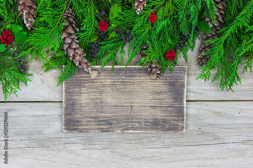 Fotografering  Blank wood sign with holiday garland border