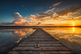 Fototapeta Krajobraz - Small Dock and Boat at the lake