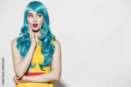 Fotografie, Obraz  Pop art woman portrait wearing blue curly wig and bright yellow