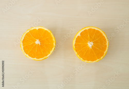 Photo Stands Slices of fruit Top view - Orange fruit on wooden background