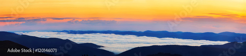 Poster Melon Picturesque sunrise morning in mountains above clouds, Carpathia