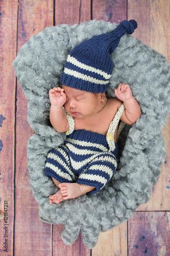 A newborn baby boy sleeping in a basket wearing a blue hat - Buy ... 38b1b71059bc