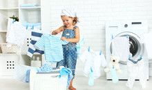Child Fun Happy Little Girl  To Wash Clothes And Laughs In Laund