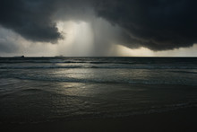 Dramatic Seascape With Storm And Rain And Dark Clouds
