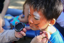 Young Boy Getting Face Painted...