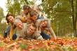 Leinwandbild Motiv Family relaxing in autumn park