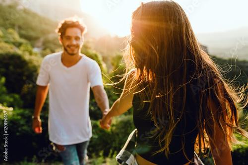 Fotografie, Obraz  Beautiful young couple enjoying nature at mountain peak.