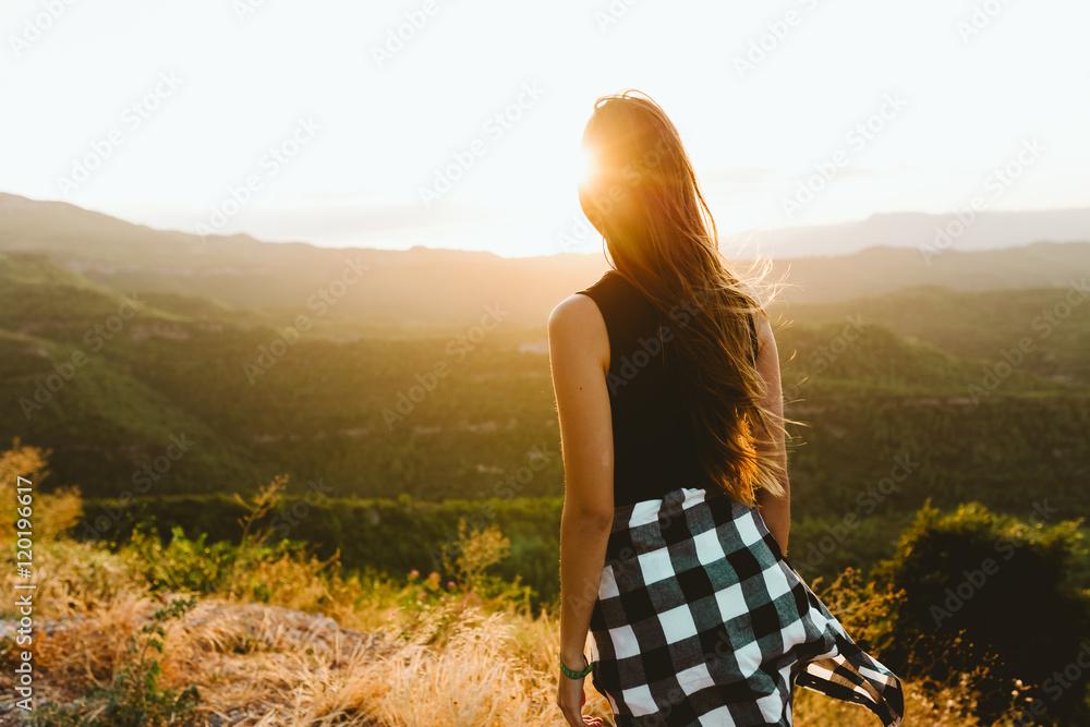 Fototapety, obrazy: Beautiful young woman enjoying nature at mountain peak.